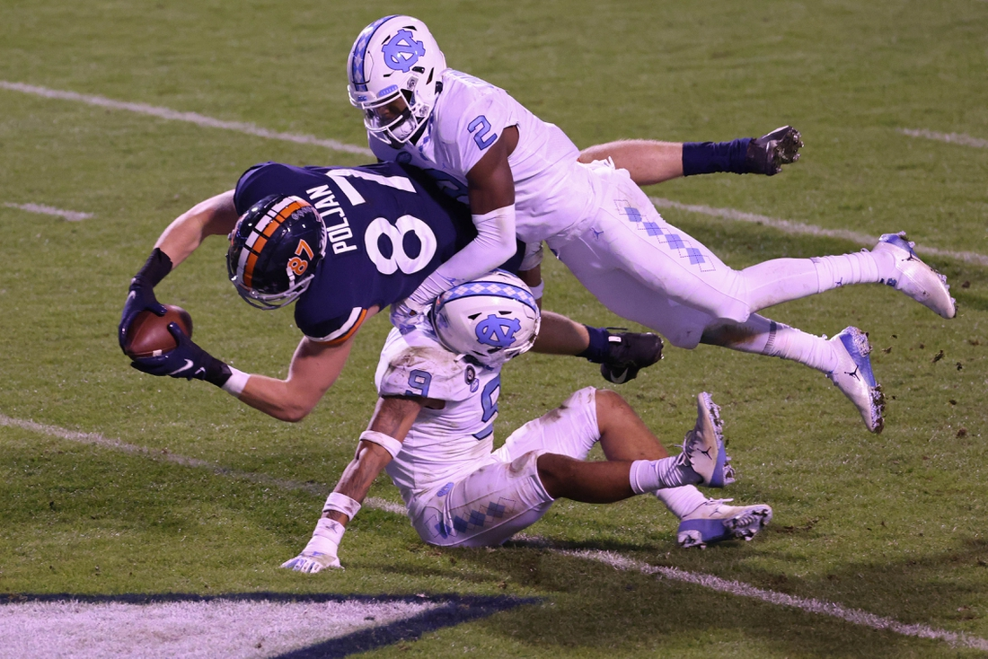 Oct 31, 2020; Charlottesville, Virginia, USA; Virginia Cavaliers tight end Tony Poljan (87) dives into the end zone to score a touchdown as Carolina Tar Heels defensive back Cam'Ron Kelly (9) and Tar Heels defensive back Don Chapman (2) defend in the third quarter at Scott Stadium. Mandatory Credit: Geoff Burke-USA TODAY Sports