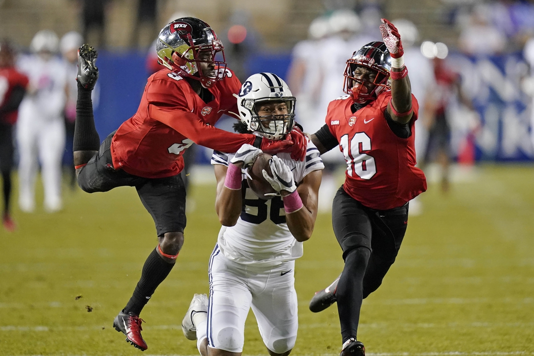 Oct 31, 2020; Provo, UT, USA; Western Kentucky players Dominique Bradshaw, left, and Kendrick Simpkins (16) defend on an incomplete pass to BYU wide receiver Keanu Hill during the first half of an NCAA college football game Saturday, Oct. 31, 2020, in Provo, Utah. Mandatory Credit: Rick Bowmer/Pool Photo-USA TODAY Sports