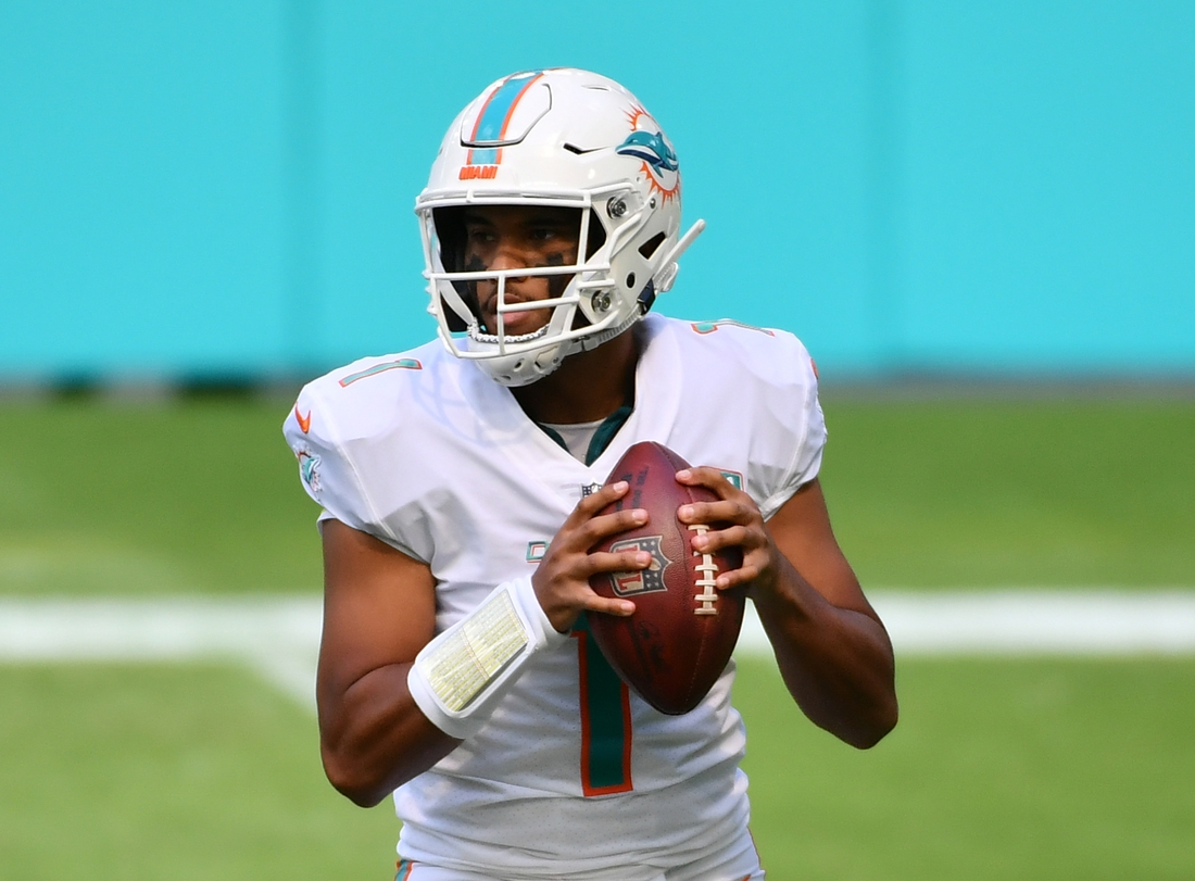 Nov 1, 2020; Miami Gardens, Florida, USA; Miami Dolphins quarterback Tua Tagovailoa (1) drops back to pass against the Los Angeles Rams in the first quarter at Hard Rock Stadium. Mandatory Credit: Jasen Vinlove-USA TODAY Sports
