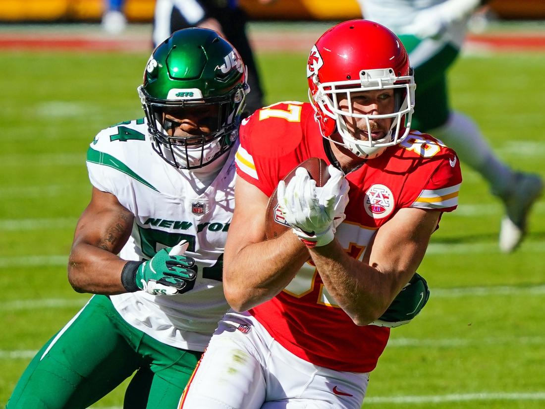 Nov 1, 2020; Kansas City, Missouri, USA; Kansas City Chiefs tight end Travis Kelce (87) is tackled by New York Jets inside linebacker Avery Williamson (54) during the first half at Arrowhead Stadium. Mandatory Credit: Jay Biggerstaff-USA TODAY Sports