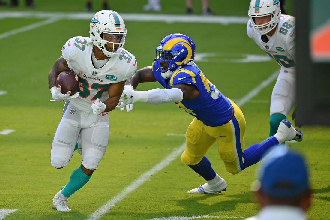 Nov 1, 2020; Miami Gardens, Florida, USA; Miami Dolphins running back Myles Gaskin (37) runs the ball against the Los Angeles Rams during the first half at Hard Rock Stadium. Mandatory Credit: Jasen Vinlove-USA TODAY Sports