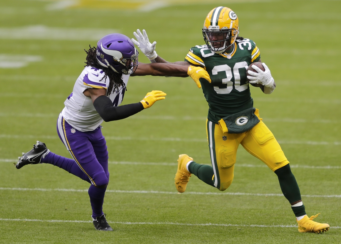 Nov 1, 2020; Green Bay, Wisconsin, USA;  Green Bay Packers running back Jamaal Williams (30) runs for a gain against Minnesota Vikings free safety Anthony Harris (41) at Lambeau Field. Dan Powers/Appleton Post-Crescent via USA TODAY NETWORK