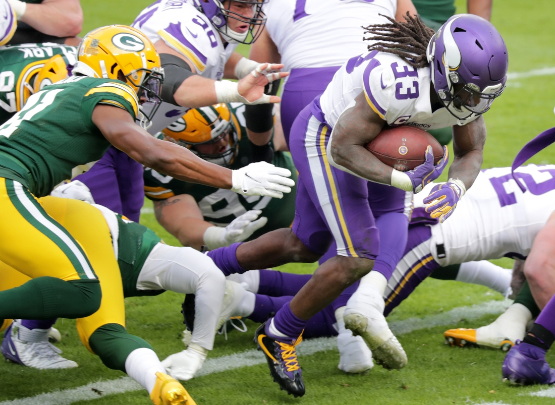 Nov 1, 2020; Green Bay, Wisconsin, USA;  Minnesota Vikings running back Dalvin Cook (33) rushes for a second quarter touchdown against the Green Bay Packers at Lambeau Field. Mandatory Credit: William Glasheen/Appleton Post-Crescent via USA TODAY NETWORK