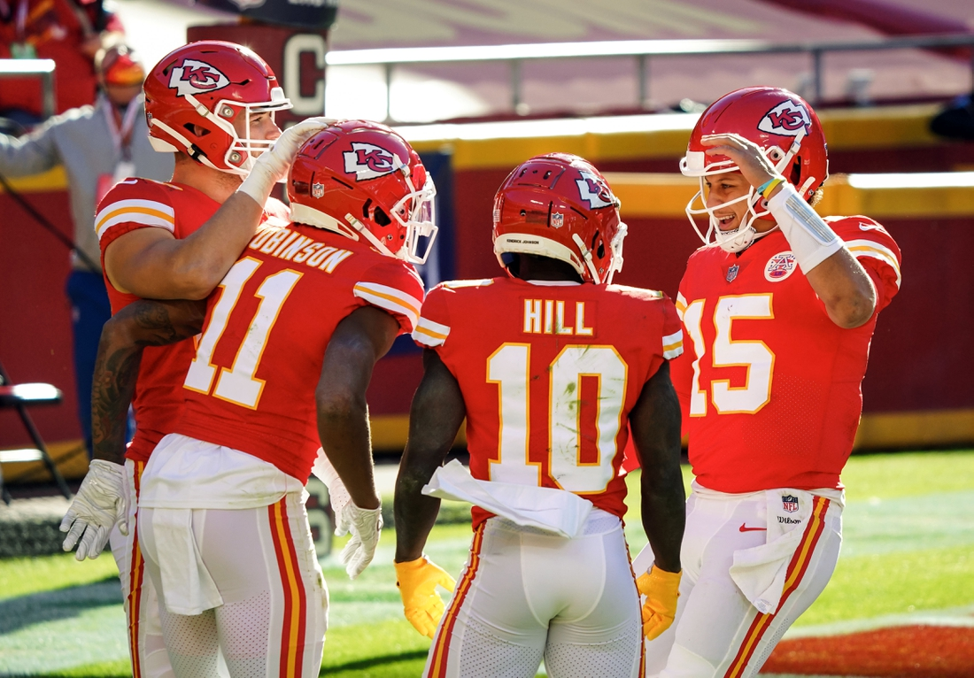 Nov 1, 2020; Kansas City, Missouri, USA; Kansas City Chiefs wide receiver Demarcus Robinson (11) is congratulated by quarterback Patrick Mahomes (15) and tight end Nick Keizer (48) and wide receiver Tyreek Hill (10) after scoring a touchdown against the New York Jets during the second half at Arrowhead Stadium. Mandatory Credit: Jay Biggerstaff-USA TODAY Sports