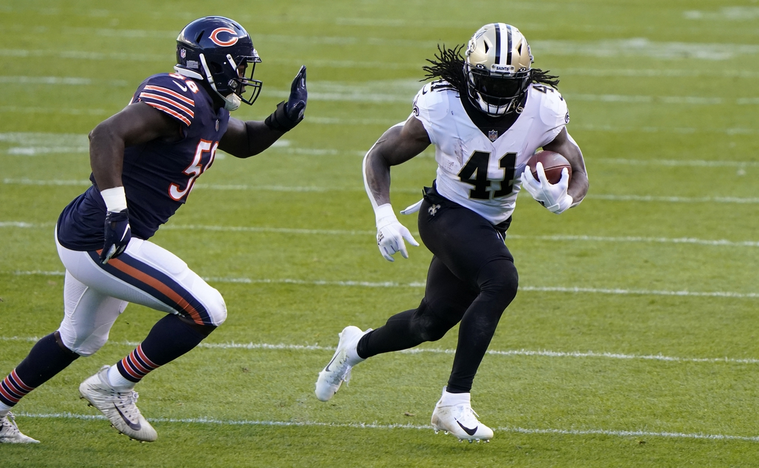 Nov 1, 2020; Chicago, Illinois, USA; New Orleans Saints running back Alvin Kamara (41) rushes the ball against the Chicago Bears during the first quarter at Soldier Field. Mandatory Credit: Mike Dinovo-USA TODAY Sports