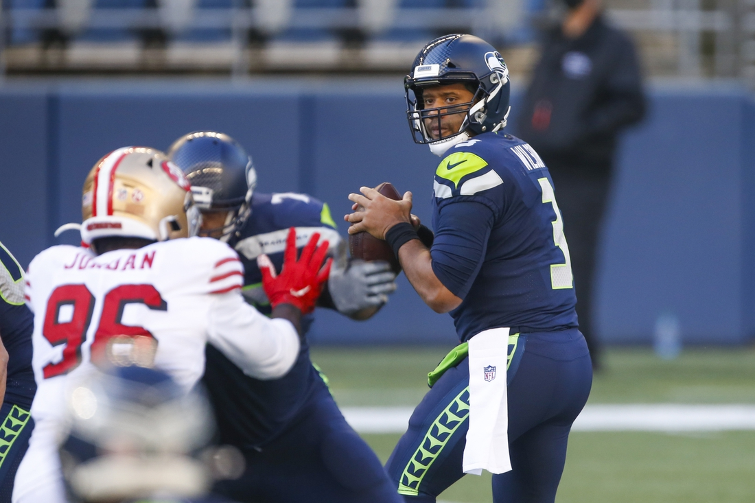 Nov 1, 2020; Seattle, Washington, USA; Seattle Seahawks quarterback Russell Wilson (3) drops back to pass against the San Francisco 49ers during the first quarter at CenturyLink Field. Mandatory Credit: Joe Nicholson-USA TODAY Sports