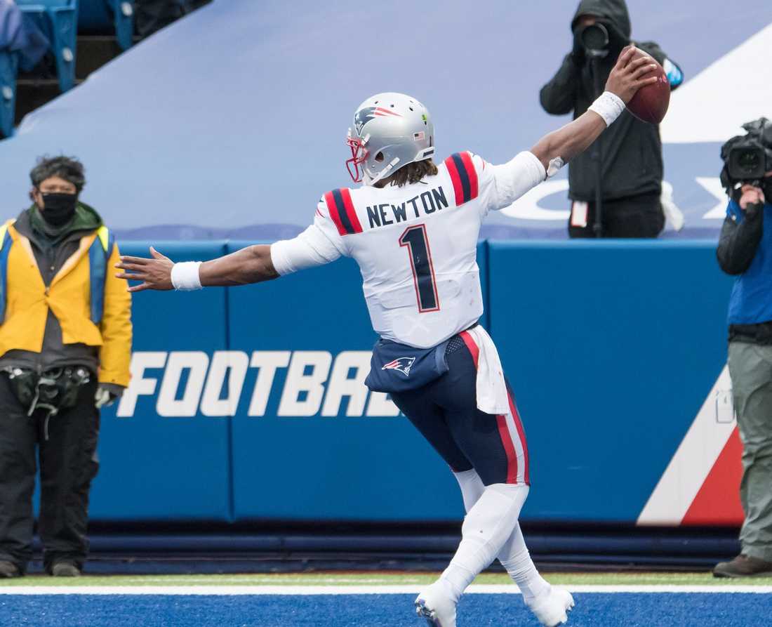 Nov 1, 2020; Orchard Park, New York, USA; New England Patriots quarterback Cam Newton (1) scores a touchdown  against the Buffalo Bills in the fourth quarter at Bills Stadium. Mandatory Credit: Mark Konezny-USA TODAY Sports