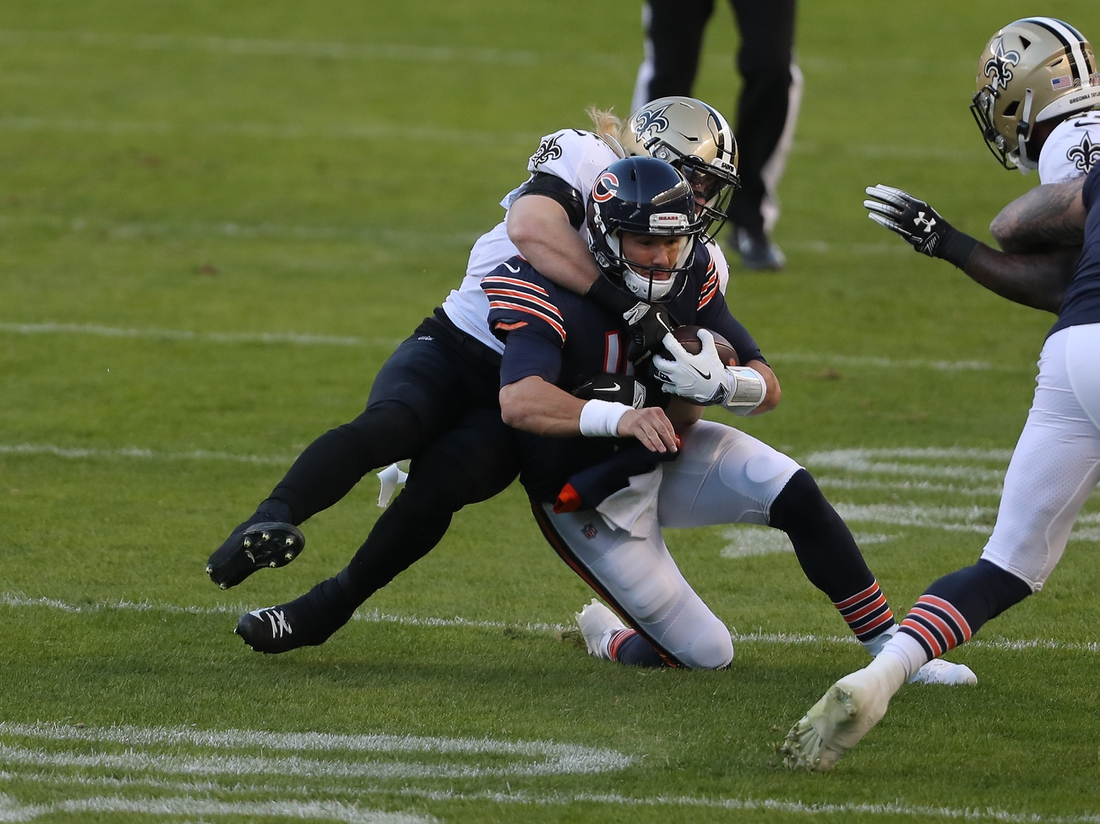 Nov 1, 2020; Chicago, Illinois, USA; Chicago Bears quarterback Mitchell Trubisky (10) is tackled by New Orleans Saints middle linebacker Alex Anzalone (47) during the first quarter at Soldier Field. Mandatory Credit: Dennis Wierzbicki-USA TODAY Sports