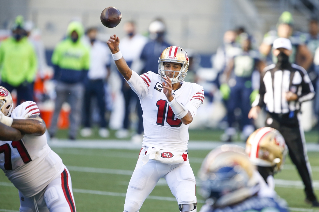 Nov 1, 2020; Seattle, Washington, USA; San Francisco 49ers quarterback Jimmy Garoppolo (10) passes against the Seattle Seahawks during the second quarter at CenturyLink Field. Mandatory Credit: Joe Nicholson-USA TODAY Sports