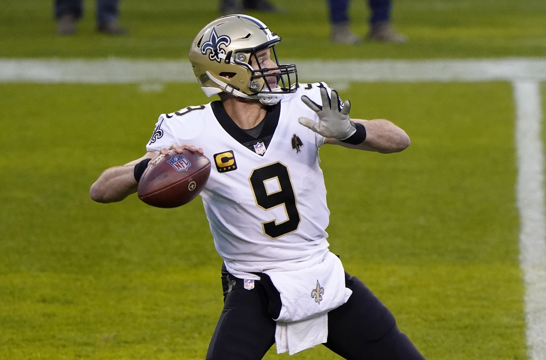 Nov 1, 2020; Chicago, Illinois, USA; New Orleans Saints quarterback Drew Brees (9) drops back to pass against the Chicago Bears during the second quarter at Soldier Field. Mandatory Credit: Mike Dinovo-USA TODAY Sports