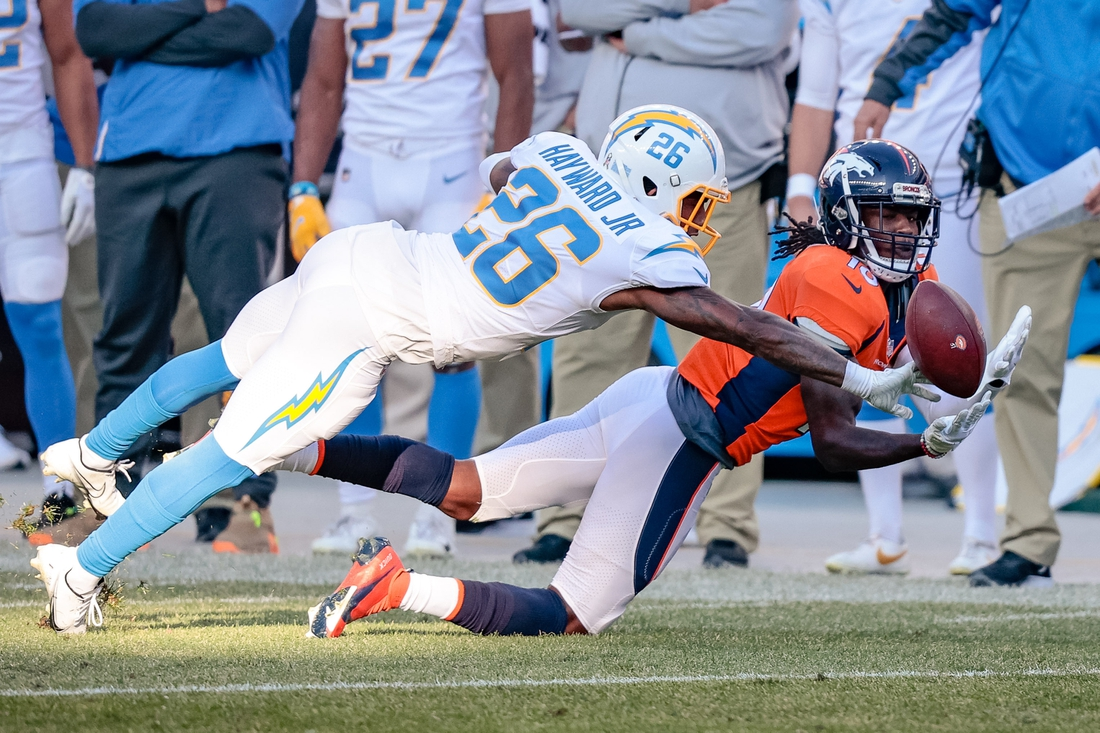 Nov 1, 2020; Denver, Colorado, USA; Los Angeles Chargers cornerback Casey Hayward Jr. (26) breaks up a pass intended for Denver Broncos wide receiver Jerry Jeudy (10) in the second quarter at Empower Field at Mile High. Mandatory Credit: Isaiah J. Downing-USA TODAY Sports