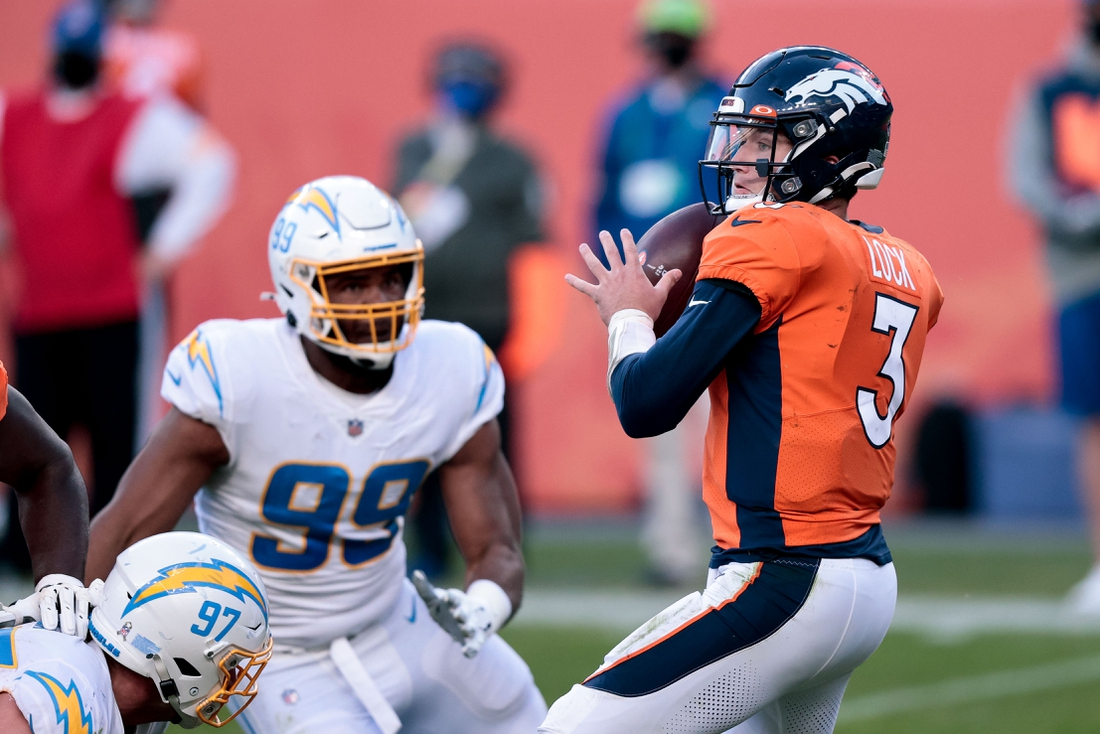 Nov 1, 2020; Denver, Colorado, USA; Denver Broncos quarterback Drew Lock (3) looks to pass under pressure from Los Angeles Chargers defensive tackle Jerry Tillery (99) in the third quarter at Empower Field at Mile High. Mandatory Credit: Isaiah J. Downing-USA TODAY Sports