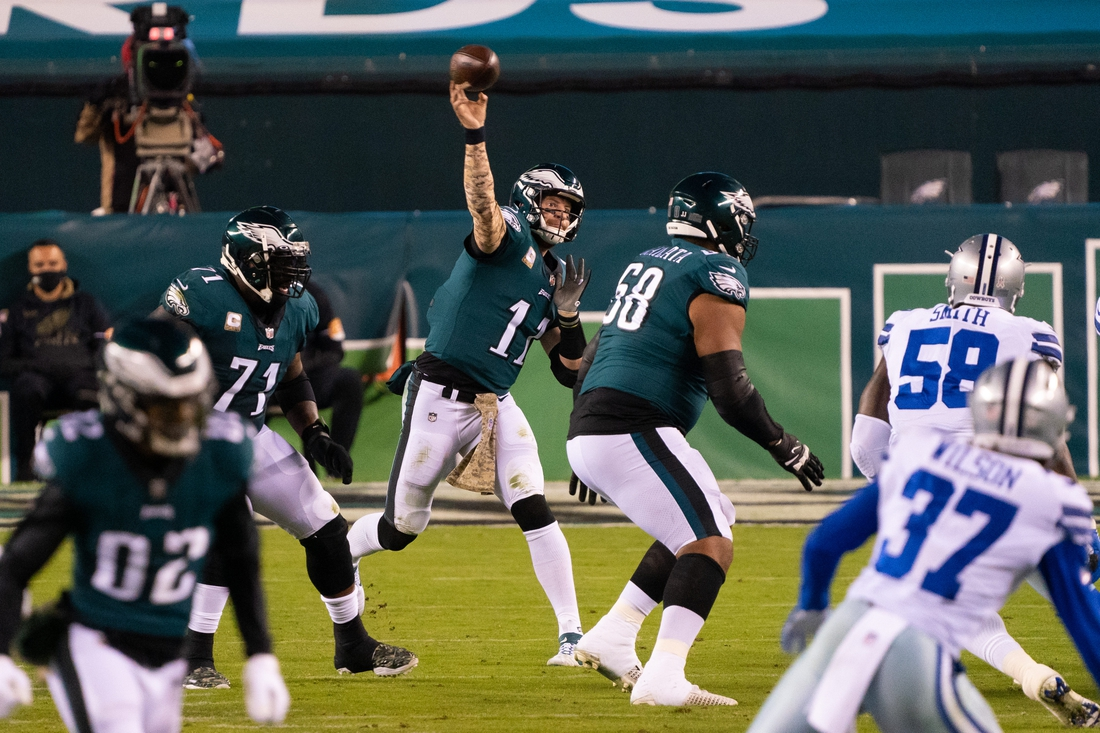 Nov 1, 2020; Philadelphia, Pennsylvania, USA; Philadelphia Eagles quarterback Carson Wentz (11) passes against the Dallas Cowboys during the second quarter at Lincoln Financial Field. Mandatory Credit: Bill Streicher-USA TODAY Sports