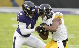 Nov 1, 2020; Baltimore, Maryland, USA;  Pittsburgh Steelers wide receiver JuJu Smith-Schuster (19) fights for extra yards as Baltimore Ravens cornerback Marlon Humphrey (44) defends during the second half at M&T Bank Stadium. Mandatory Credit: Tommy Gilligan-USA TODAY Sports