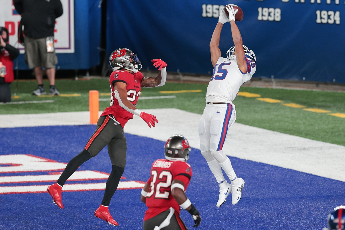 Nov 2, 2020; East Rutherford, New Jersey, USA; New York Giants wide receiver Golden Tate (15) catches a touchdown pass in front of Tampa Bay Buccaneers cornerback Sean Murphy-Bunting (23) during the second half at MetLife Stadium. Mandatory Credit: Vincent Carchietta-USA TODAY Sports