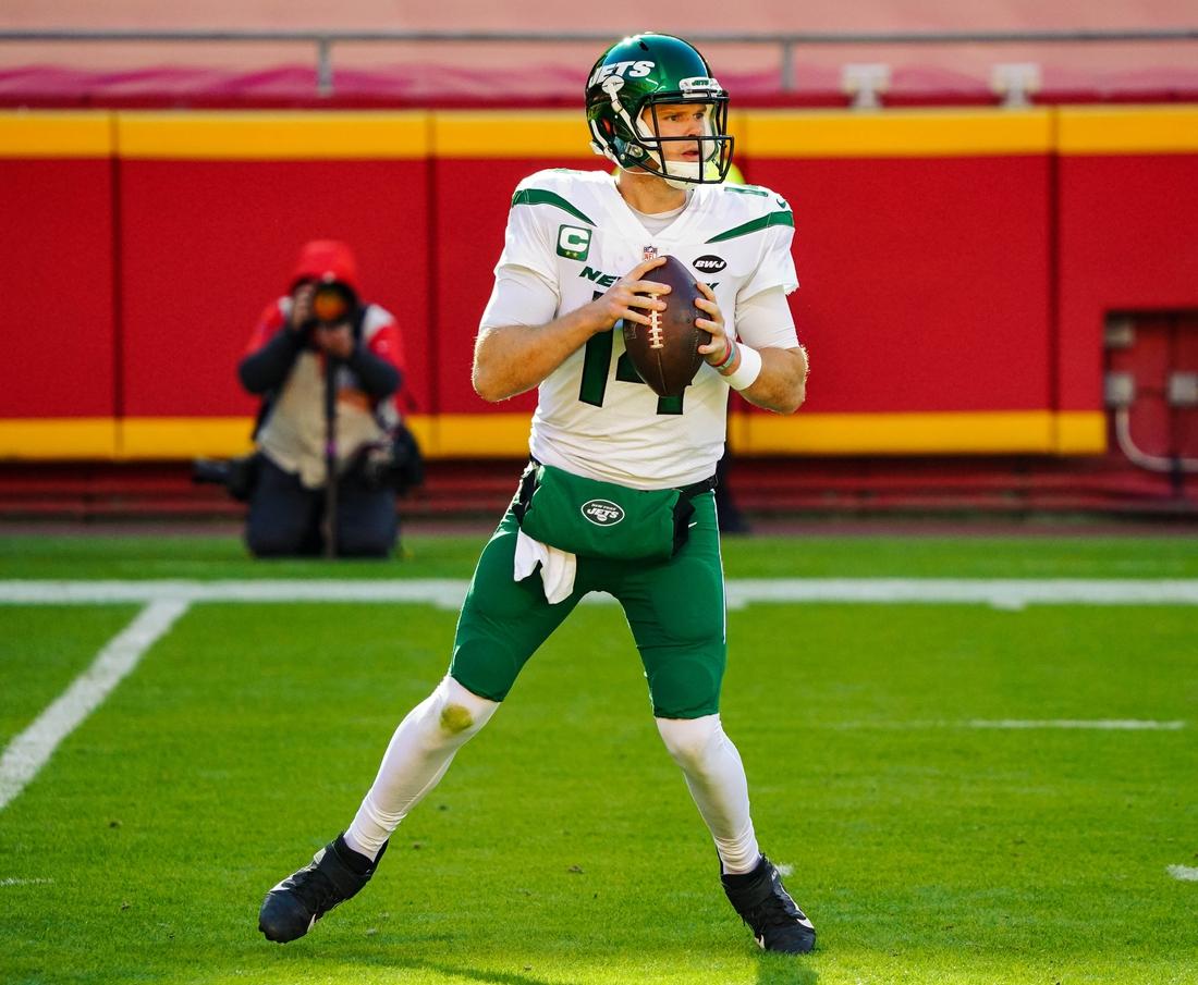 Nov 1, 2020; Kansas City, Missouri, USA; New York Jets quarterback Sam Darnold  (14) drops back to pass against the Kansas City Chiefs during the second half at Arrowhead Stadium. Mandatory Credit: Jay Biggerstaff-USA TODAY Sports