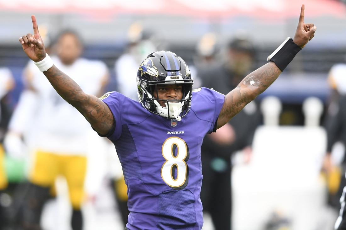 Nov 1, 2020; Baltimore, Maryland, USA;  Baltimore Ravens quarterback Lamar Jackson (8) celebrates a touchdown during a game against the Pittsburgh Steelers at M&T Bank Stadium at M&T Bank Stadium. Mandatory Credit: Mitchell Layton-USA TODAY Sports