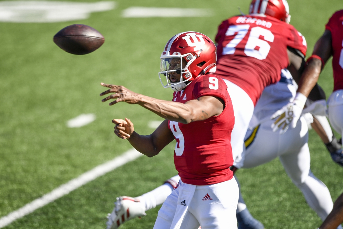 Nov 7, 2020; Bloomington, Indiana, USA; Indiana Hoosiers quarterback Michael Penix Jr. (9) throws a pass during the first quarter of the game against the Michigan Wolverines at Memorial Stadium. Mandatory Credit: Marc Lebryk-USA TODAY Sports