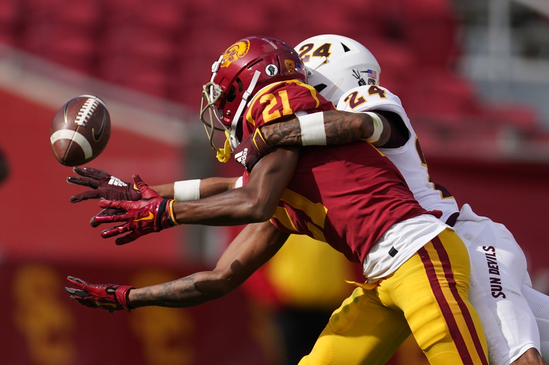 Nov 7, 2020; Los Angeles CA, USA; Southern California Trojans wide receiver Tyler Vaughns (21) is defended by Arizona State Sun Devils defensive back Chase Lucas (24) in the second quarter at the Los Angeles Memorial Coliseum. Mandatory Credit: Kirby Lee-USA TODAY Sports
