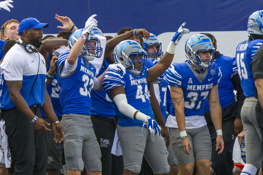 Nov 7, 2020; Memphis, Tennessee, USA;  Memphis Tigers players celebrate during the second half against the South Florida Bulls at Liberty Bowl Memorial Stadium. Mandatory Credit: Justin Ford-USA TODAY Sports