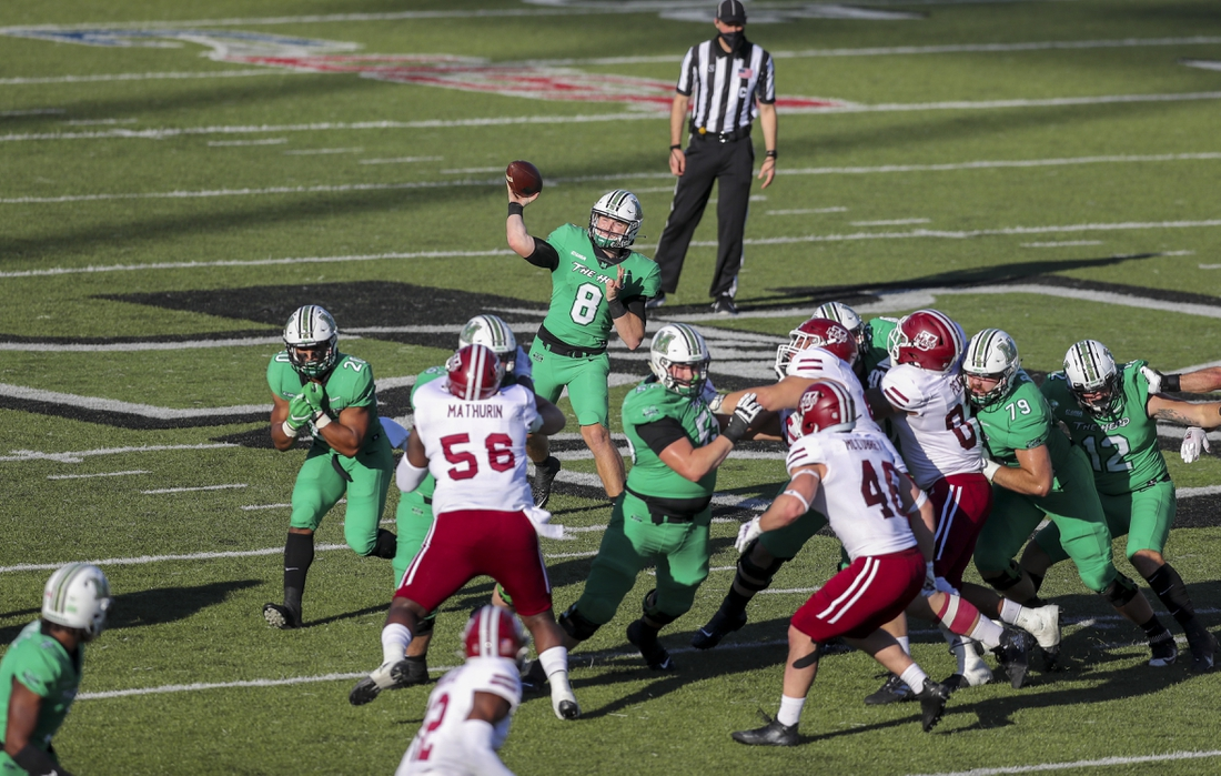 Nov 7, 2020; Huntington, West Virginia, USA; Marshall Thundering Herd quarterback Grant Wells (8) throws a pass during the second quarter against the Massachusetts Minutemen at Joan C. Edwards Stadium. Mandatory Credit: Ben Queen-USA TODAY Sports