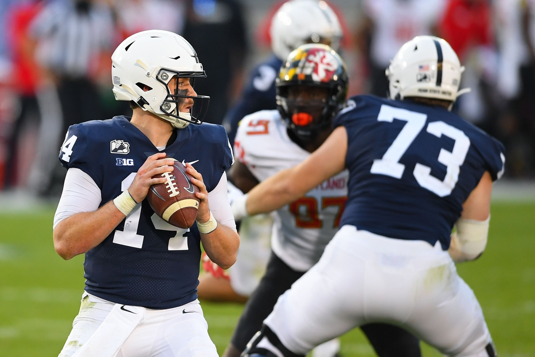 Nov 7, 2020; University Park, Pennsylvania, USA; Penn State Nittany Lions quarterback Sean Clifford (14) drops back to pass against the Maryland Terrapins during the second quarter at Beaver Stadium. Mandatory Credit: Rich Barnes-USA TODAY Sports