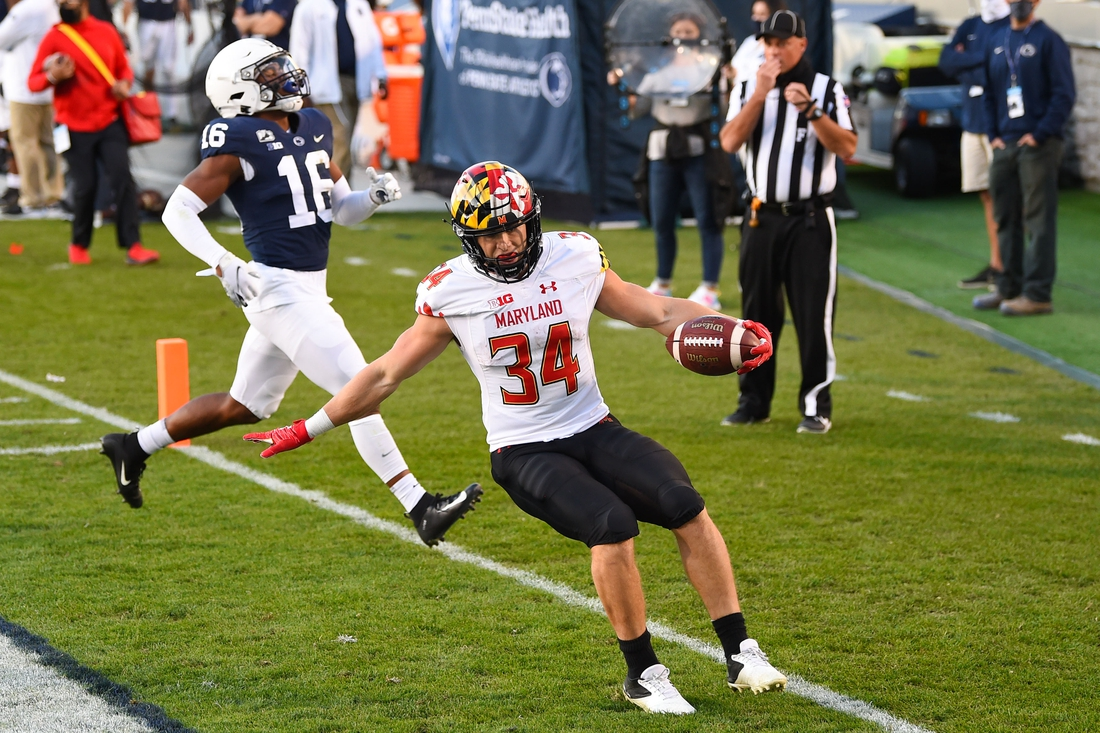 Nov 7, 2020; University Park, Pennsylvania, USA; Maryland Terrapins running back Jake Funk (34) reacts to his touchdown run in front of Penn State Nittany Lions safety Ji'Ayir Brown (16) during the second quarter at Beaver Stadium. Mandatory Credit: Rich Barnes-USA TODAY Sports