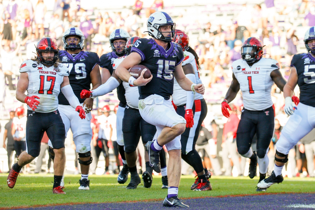 Nov 7, 2020; Fort Worth, Texas, USA; TCU Horned Frogs quarterback Max Duggan (15) scores a touchdown against the Texas Tech Red Raiders during the second quarter at Amon G. Carter Stadium. Mandatory Credit: Andrew Dieb-USA TODAY Sports