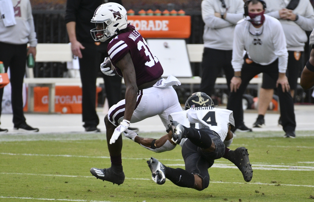 Nov 7, 2020; Starkville, Mississippi, USA; Mississippi State Bulldogs wide receiver Jaden Walley (31) runs with the ball while defended by Vanderbilt Commodores safety Maxwell Worship (R) during the second quarter at Davis Wade Stadium at Scott Field. Mandatory Credit: Matt Bush-USA TODAY Sports