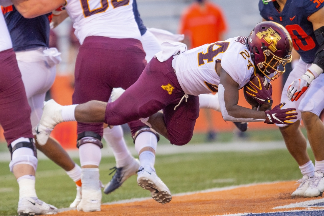 Nov 7, 2020; Champaign, Illinois, USA; Minnesota Golden Gophers running back Mohamed Ibrahim (24) dives in for a touchdown against the Illinois Fighting Illini  during the first half at Memorial Stadium. Mandatory Credit: Patrick Gorski-USA TODAY Sports