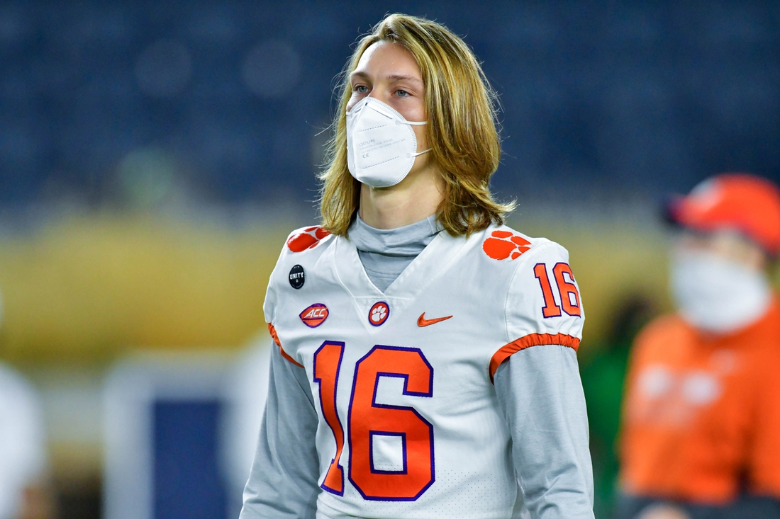 Nov 7, 2020; South Bend, Indiana, USA; Clemson Tigers quarterback Trevor Lawrence (16) watches warmups before the game against the Notre Dame Fighting Irish at Notre Dame Stadium. Mandatory Credit: Matt Cashore-USA TODAY Sports