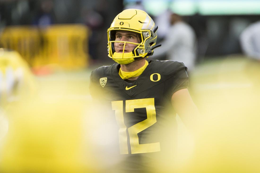 Nov 7, 2020; Eugene, Oregon, USA; Oregon Ducks quarterback Tyler Shough (12) warms up before the start of a game against the Stanford Cardinals at Autzen Stadium. Mandatory Credit: Troy Wayrynen-USA TODAY Sports
