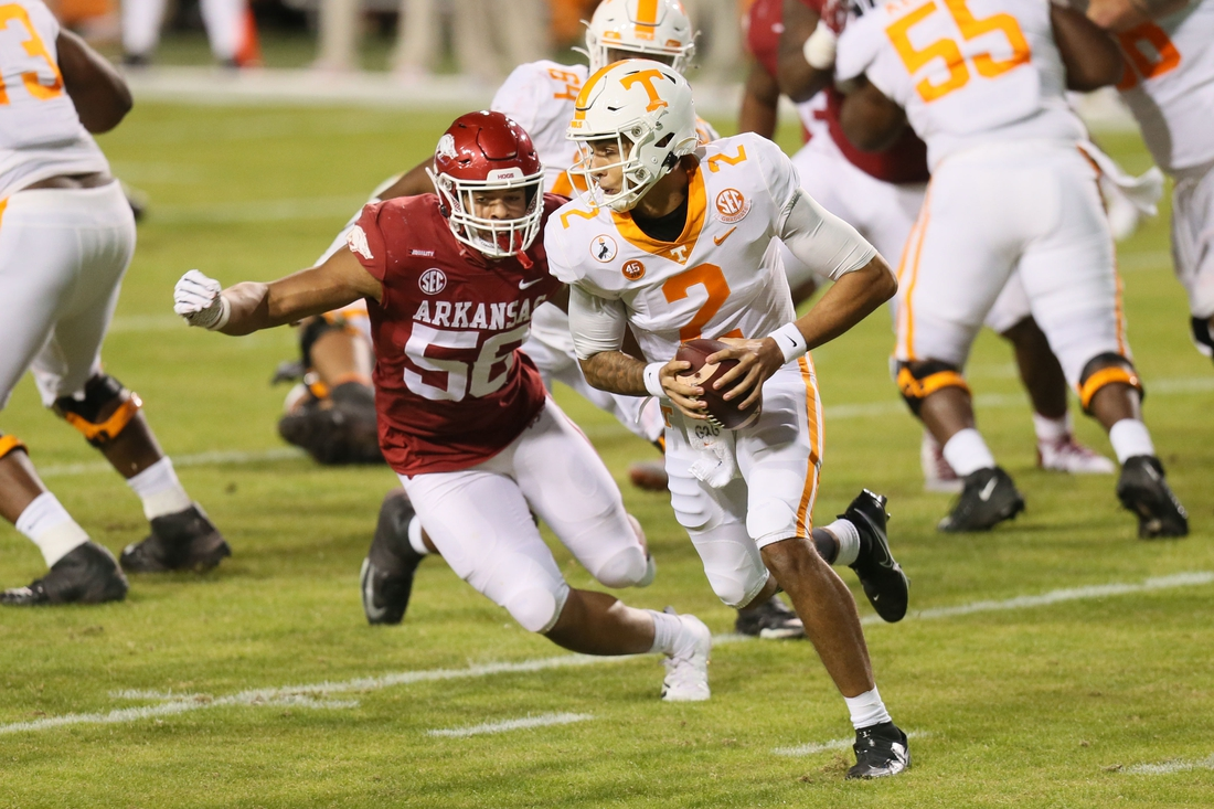 Nov 7, 2020; Fayetteville, Arkansas, USA; Tennessee Volunteers quarterback Jarrett Guarantano (2) runs the ball as Arkansas Razorbacks linebacker Zach Williams (56) defends in the first quarter at Donald W. Reynolds Razorback Stadium. Mandatory Credit: Nelson Chenault-USA TODAY Sports