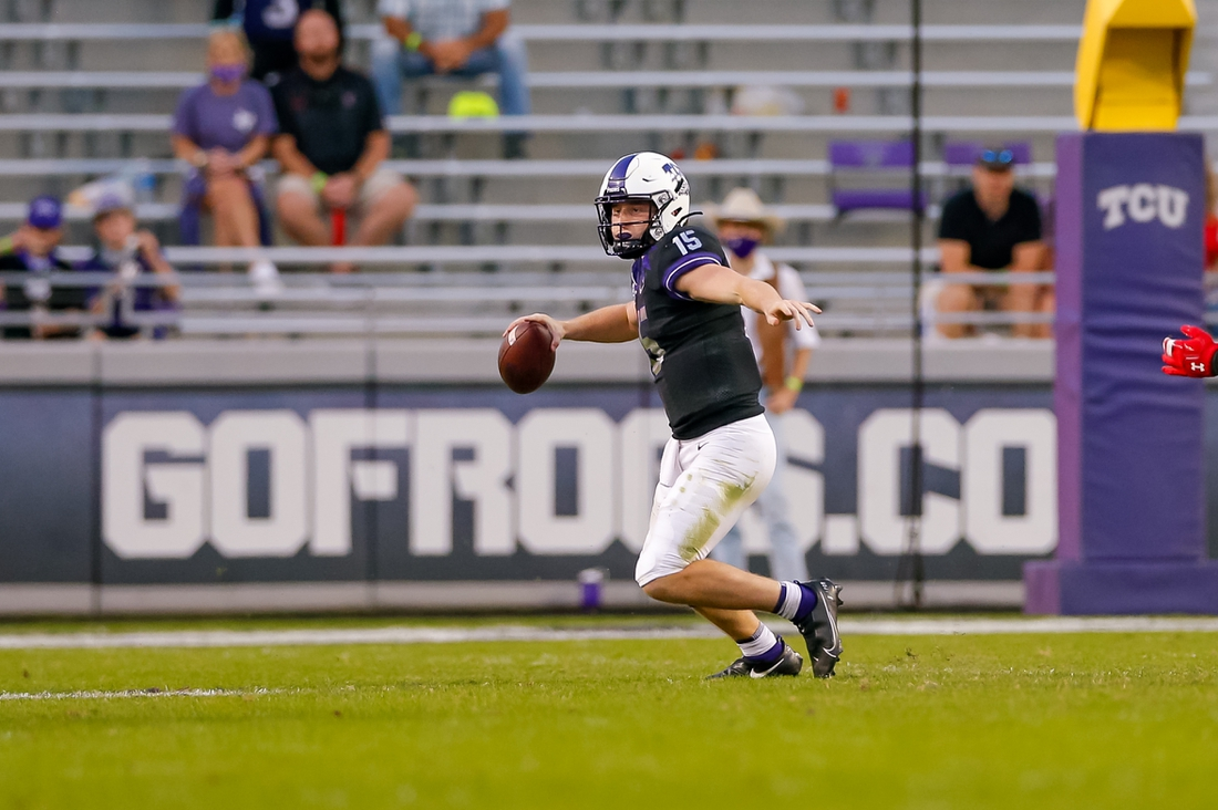 Nov 7, 2020; Fort Worth, Texas, USA; TCU Horned Frogs quarterback Max Duggan (15) scrambles out of the pocket during the fourth quarter against the Texas Tech Red Raiders at Amon G. Carter Stadium. Mandatory Credit: Andrew Dieb-USA TODAY Sports