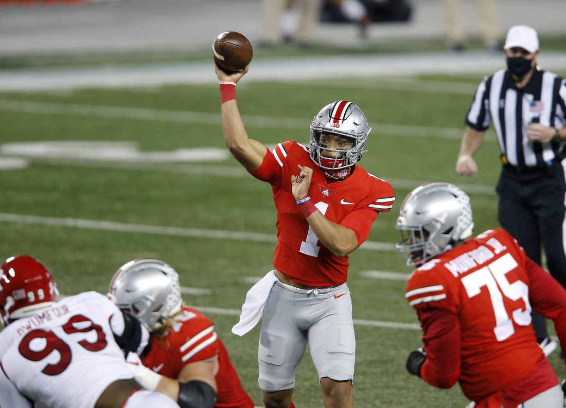 Nov 7, 2020; Columbus, Ohio, USA; Ohio State Buckeyes quarterback Justin Fields (1) throws during the first quarter against the Rutgers Scarlet Knights at Ohio Stadium. Mandatory Credit: Joseph Maiorana-USA TODAY Sports