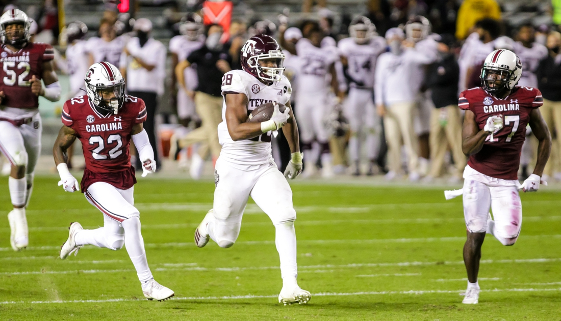 Nov 7, 2020; Columbia, South Carolina, USA; Texas A&M Aggies running back Isaiah Spiller (28) rushes for a long gain against the South Carolina Gamecocks in the second quarter at Williams-Brice Stadium. Mandatory Credit: Jeff Blake-USA TODAY Sports