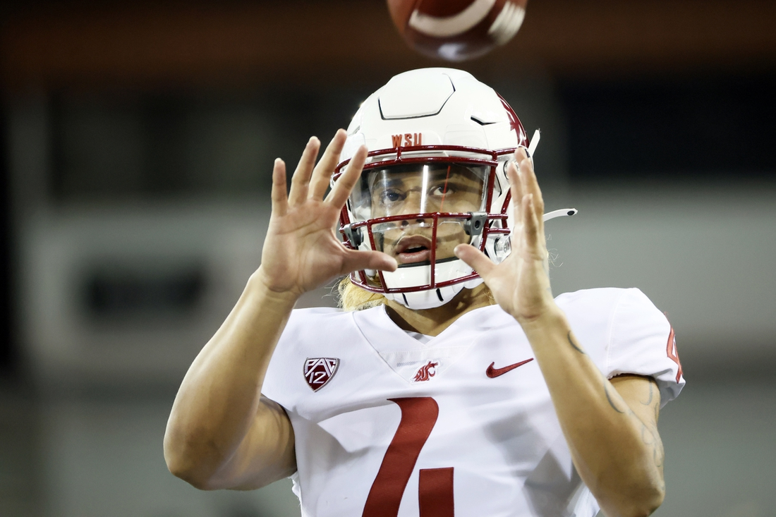 Nov 7, 2020; Corvallis, Oregon, USA; Washington State Cougars quarterback Jayden de Laura (4) warms up prior to the game against the Oregon State Beavers at Reser Stadium. Mandatory Credit: Soobum Im-USA TODAY Sports