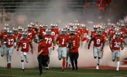 Nov 7, 2020; Columbus, Ohio, USA; Ohio State Buckeyes quarterback Justin Fields (1) leads the team before the game against the Rutgers Scarlet Knights at Ohio Stadium. Mandatory Credit: Joseph Maiorana-USA TODAY Sports