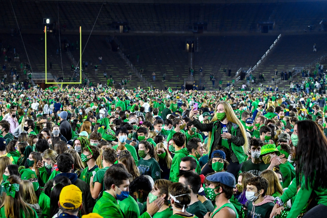 Nov 7, 2020; South Bend, Indiana, USA; Fans storm the field after the Notre Dame Fighting Irish defeated the Clemson Tigers 47-40 in two overtimes. Mandatory Credit: Matt Cashore-USA TODAY Sports