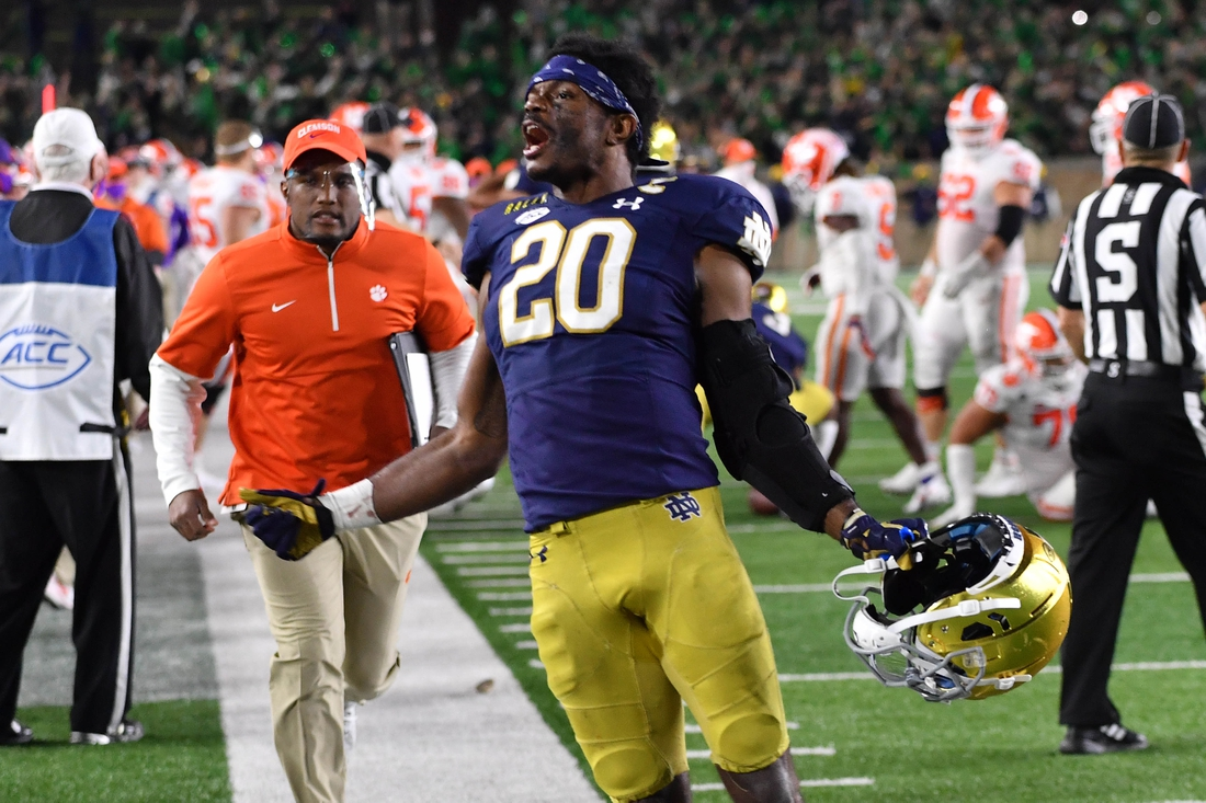 Nov 7, 2020; South Bend, Indiana, USA; Notre Dame Fighting Irish safety Shaun Crawford (20) celebrates after Notre Dame defeated the Clemson Tigers 47-40 in two overtimes. Mandatory Credit: Matt Cashore-USA TODAY Sports