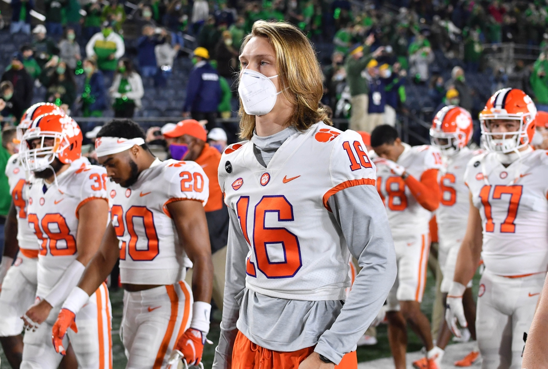 Nov 7, 2020; South Bend, Indiana, USA; Clemson Tigers quarterback Trevor Lawrence (16) leaves the field with his teammates after Clemson lost to Notre Dame 47-40 in two overtimes at Notre Dame Stadium. Mandatory Credit: Matt Cashore-USA TODAY Sports