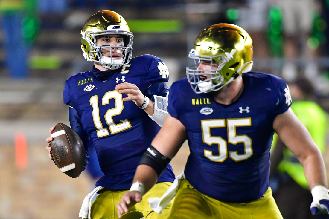 Nov 7, 2020; South Bend, Indiana, USA; Notre Dame Fighting Irish quarterback Ian Book (12) looks to throw in the second quarter against the Clemson Tigers at Notre Dame Stadium. Notre Dame defeated Clemson 47-40 in two overtimes. Mandatory Credit: Matt Cashore-USA TODAY Sports