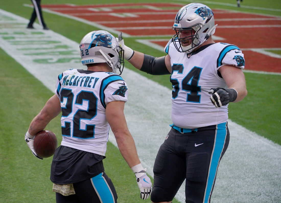 Nov 8, 2020; Kansas City, Missouri, USA; Carolina Panthers running back Christian McCaffrey (22) celebrates with offensive lineman Chris Reed (64) after scoring against the Carolina Panthers during the first half at Arrowhead Stadium. Mandatory Credit: Denny Medley-USA TODAY Sports