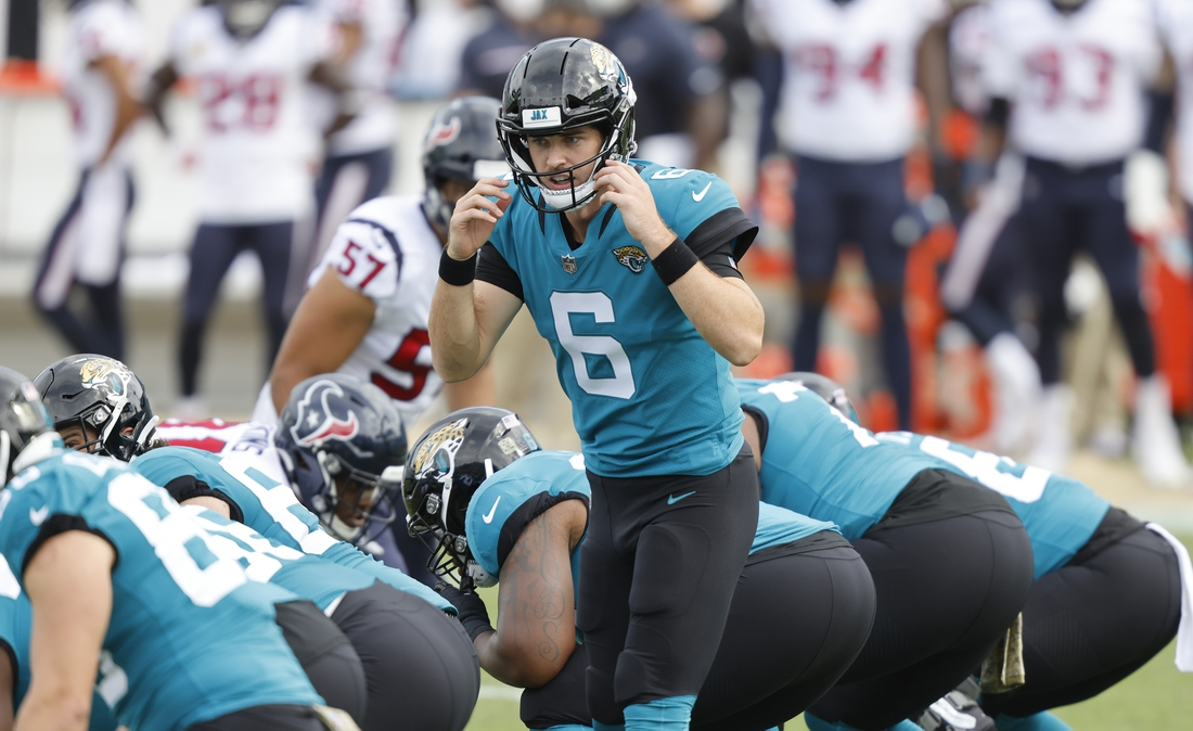 Nov 8, 2020; Jacksonville, Florida, USA; Jacksonville Jaguars quarterback Jake Luton (6) changes the play at the line against the Houston Texans during the first quarter  at TIAA Bank Field. Mandatory Credit: Reinhold Matay-USA TODAY Sports