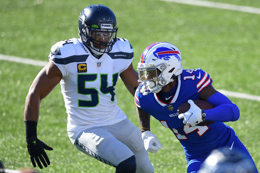 Nov 8, 2020; Orchard Park, New York, USA; Buffalo Bills wide receiver Stefon Diggs (14) runs with the ball after a catch as Seattle Seahawks middle linebacker Bobby Wagner (54) defends during the first quarter at Bills Stadium. Mandatory Credit: Rich Barnes-USA TODAY Sports