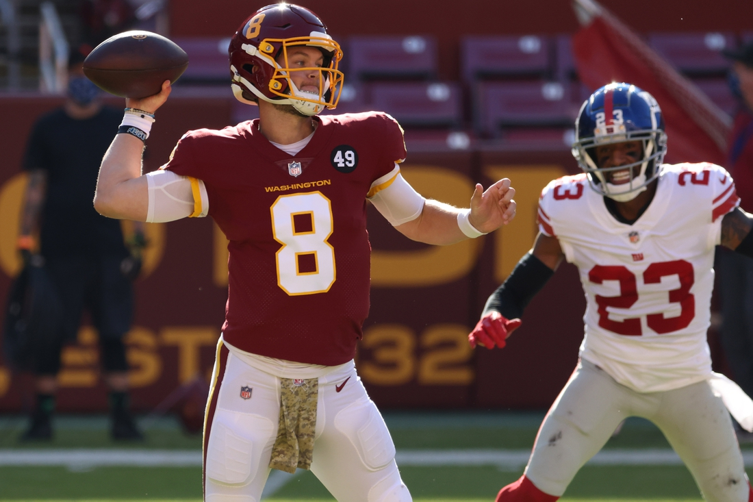 Nov 8, 2020; Landover, Maryland, USA; Washington Football Team quarterback Kyle Allen (8) passes the ball as New York Giants cornerback Logan Ryan (23) chases in the first quarter at FedExField. Mandatory Credit: Geoff Burke-USA TODAY Sports