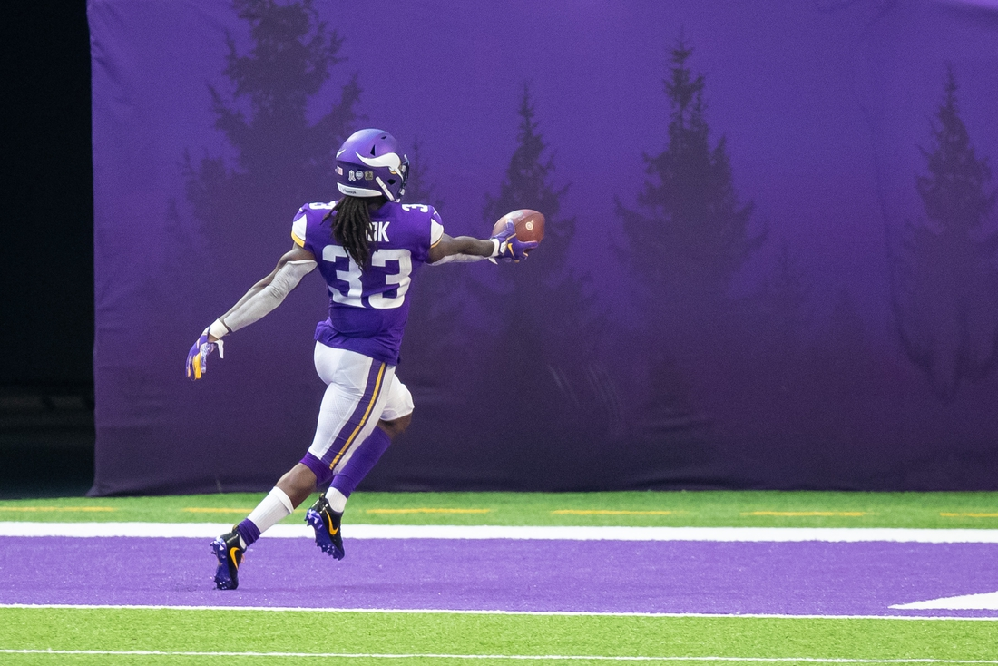 Nov 8, 2020; Minneapolis, Minnesota, USA; Minnesota Vikings running back Dalvin Cook (33) celebrates his touchdown in the fourth quarter against the Detroit Lions at U.S. Bank Stadium. Mandatory Credit: Brad Rempel-USA TODAY Sports