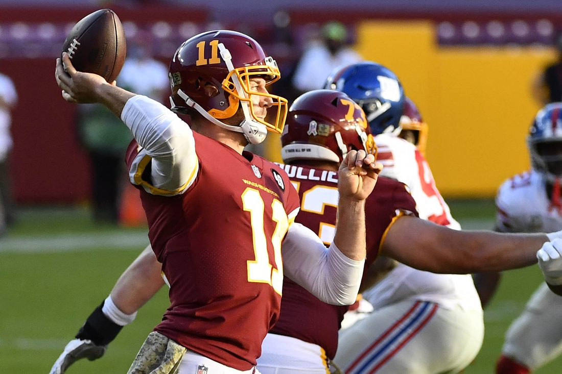 Nov 8, 2020; Landover, Maryland, USA;  Washington Football Team quarterback Alex Smith (11) attempts a pass against the New York Giants during the fourth quarter at FedExField. Mandatory Credit: Brad Mills-USA TODAY Sports