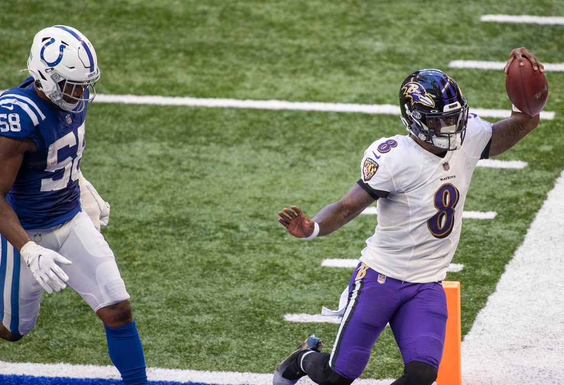 Nov 8, 2020; Indianapolis, Indiana, USA; Baltimore Ravens quarterback Lamar Jackson (8) scores a touchdown against the Indianapolis Colts in the second half at Lucas Oil Stadium. Mandatory Credit: Trevor Ruszkowski-USA TODAY Sports