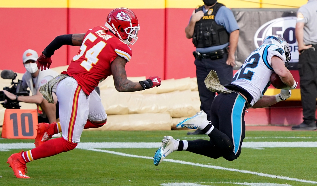 Nov 8, 2020; Kansas City, Missouri, USA; Carolina Panthers running back Christian McCaffrey (22) catches a pass against Kansas City Chiefs outside linebacker Damien Wilson (54) during the second half at Arrowhead Stadium. Mandatory Credit: Denny Medley-USA TODAY Sports